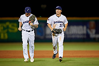 Pensacola Blue Wahoos center fielder Tanner English (4) and left fielder Ernie De La Trinidad (25) jog to the dugout during a Southern League game against the Biloxi Shuckers on May 3, 2019 at Admiral Fetterman Field in Pensacola, Florida.  Pensacola defeated Biloxi 10-8.  (Mike Janes/Four Seam Images)