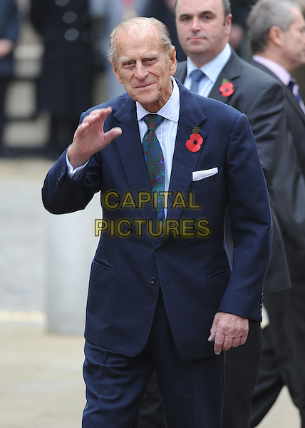 HRH PRINCE PHILIP, Duke of Edinburgh .HM THE QUEEN, Elizabeth II (2nd) & HRH PRINCE PHILIP, Duke of Edinburgh Royal Visit to Margate, Kent, England..November 11th, 2011.royals royalty half length blue suit poppy  hand waving.CAP/CAS.©Bob Cass/Capital Pictures.