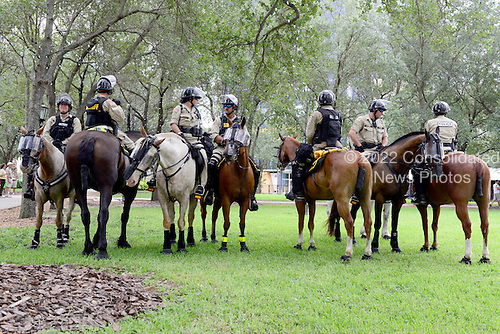 State Troopers on horseback patrol the empty park where protests are allowed near the 2012 Republican National Convention in Tampa Bay, Florida on Saturday, August 25, 2012..Credit: Ron Sachs / CNP.(RESTRICTION: NO New York or New Jersey Newspapers or newspapers within a 75 mile radius of New York City)