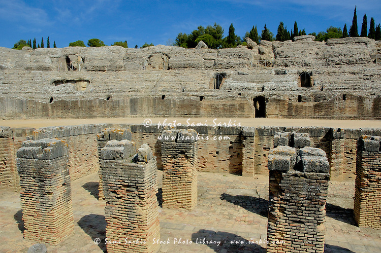 Ruined Roman amphitheatre in the ancient city of Italica, in modern day Santiponce, Seville, Andalusia, Spain.