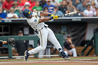Michigan Wolverines designated hitter Jordan Nwogu (42) swings the bat during Game 1 of the NCAA College World Series against the Texas Tech Red Raiders on June 15, 2019 at TD Ameritrade Park in Omaha, Nebraska. Michigan defeated Texas Tech 5-3. (Andrew Woolley/Four Seam Images)