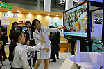 DECEMBER 10, 2009 - TOKYO - JAPAN: Kids are playing with a television game on Toshiba booth during the Eco-Product 2009 in Tokyo Big Sight. Some 700 exhibitors introduce their consumer goods, industrial materials, energies, finance and various services during three days. New environmental technologies and services that aim to change conventional wisdom, and new business models that aim to solve specific problems, including company coalitions and regional cooperation are displaying. In addition, 20,000 students in the Kanto Region as a school activity, and families can experience the low-carbon lifestyle of the near-future. 180,000 visitors are expected to attend (photo by Laurent Benchana/Nippon News).