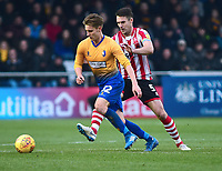 Mansfield Town's Danny Rose shields the ball from  Lincoln City's Jason Shackell<br /> <br /> Photographer Andrew Vaughan/CameraSport<br /> <br /> The EFL Sky Bet League Two - Lincoln City v Mansfield Town - Saturday 24th November 2018 - Sincil Bank - Lincoln<br /> <br /> World Copyright &copy; 2018 CameraSport. All rights reserved. 43 Linden Ave. Countesthorpe. Leicester. England. LE8 5PG - Tel: +44 (0) 116 277 4147 - admin@camerasport.com - www.camerasport.com