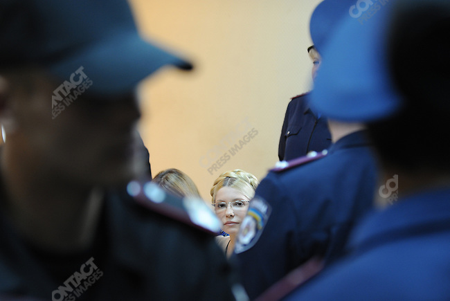 Former PM Yulia Tymoshenko in the Pechersky court where she was sentenced to 7 years imprisonment and a fine of 1.5 billion hryvna (190 million dollars or 140 million euros) was surrounded by policemen during a recess of the court. Kiev, Ukraine, October 11, 2011