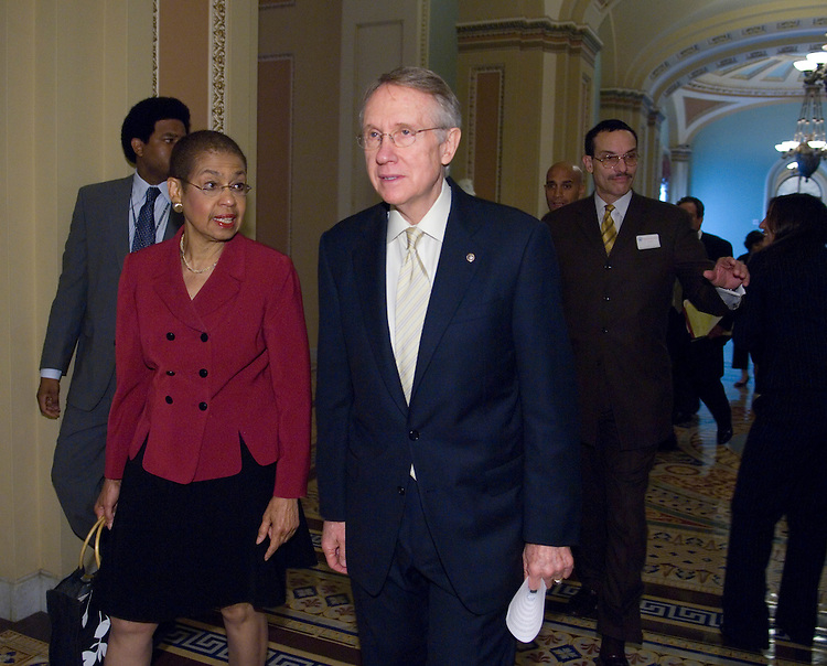 From left, Del. Eleanor Holmes Norton, D-D.C., Senate Majority Leader Harry Reid, D-Nev., D.C. Mayor Adrian Fenty, and DC City Council Chair Vincent Gray walk through the Ohio Clock Corridor on their way to a meeting to discuss Senate efforts to give Washington, D.C., residents full voting representation in the House on Wednesday, June 6, 2007.