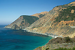 Steep coastal hills and cliffs above bridge along highway one, Big Sur Coast, Monterey County, California