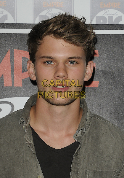 """Jeremy Irvine photocall"" as part of the Empire Presents ... Big Screen event, Big Screen Barclays Premier Lounge, O2 Arena, Greenwich, London, England..August 14th, 2011.headshot portrait beige grey gray black.CAP/CAN.©Can Nguyen/Capital Pictures."