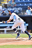 Asheville Tourists right fielder Yonathan Daza (2) swings at a pitch during a game against the Kannapolis Intimidators at McCormick Field on May 22, 2016 in Asheville, North Carolina. The Tourists defeated the Intimidators 8-4. (Tony Farlow/Four Seam Images)