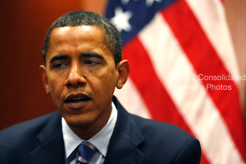 Chicago, IL - December 9, 2008 -- United States President-elect Barack Obama makes a statement to reporters after a private meeting with Vice President-elect Joe Biden and former Vice President Al Gore at Obama's transition office on December 9, 2008 in Chicago, Illinois. An Obama spokesman said the three men discussed energy and climate change and how policies in those areas could help the economy. .Credit: Brian Kersey - Pool via CNP