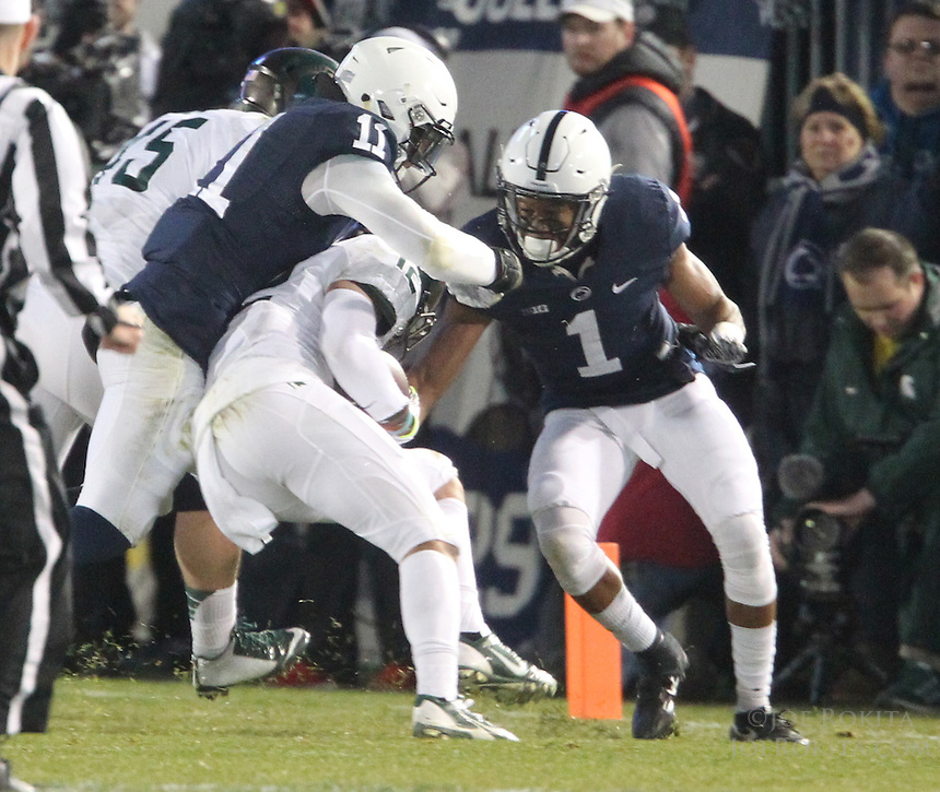 State College, PA - 11/26/2016:  Penn State senior LB Brandon Bell (11) and CB Christian Campbell tackle MSU WR R.J. Shelton. #7 Penn State defeated Michigan State by a score of 45-12 to secure the Big Ten conference East Division championship on Senior Day, Saturday, November 26, 2016, at Beaver Stadium in State College, PA.<br /> <br /> Photos by Joe Rokita / JoeRokita.com