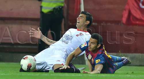 17.03.2012. Sevilla, Spain. Spanish La Liga. Picture shows Reyes (L) and Pedro(R) in action during match between Sevilla CF against FC Barcelona at Ramon Sanchez Pizjuan stadium
