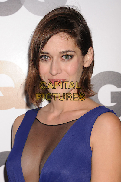 Lizzy Caplan.Arriving at the GQ Men Of The Year Party at Chateau Marmont Hotel in Los Angeles, California, USA..November 13th, 2012.headshot portrait blue sleeveless sheer plunging neckline cleavage black  .CAP/ROT/TM.©Tony Michaels/Roth Stock/Capital Pictures