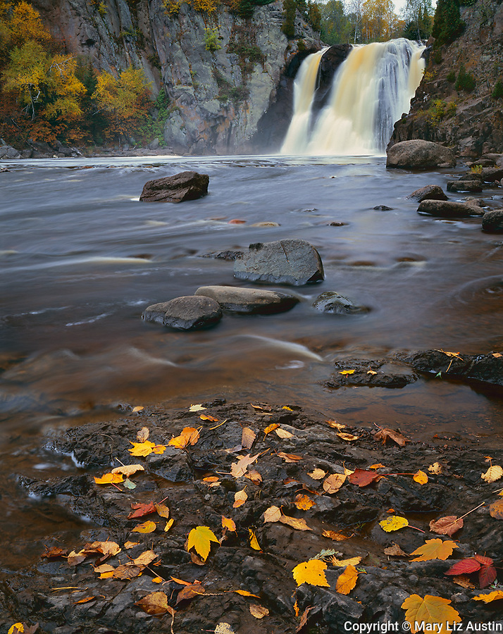 Tettegouche State Park, MN: High Falls on the Baptism River with fall colored birch trees at the river's edge