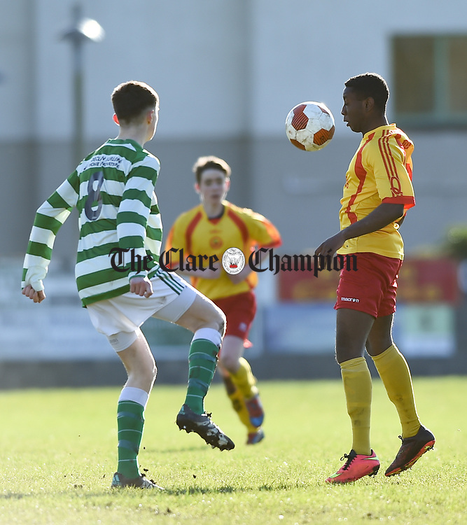 Cormac Power of Villa, Waterford  in action against Sultan Owolebi of Avenue during their  FAI U-17 cup  semi-final in Roslevan. Photograph by John Kelly.