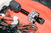 A Fox News microphone lays in an equipment bag as Republican presidential candidate and former Florida governor Jeb Bush speaks at a town hall in Souhegan High School in Amherst, New Hampshire.