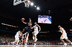 SAN ANTONIO, TX - APRIL 02: Naji Ozeir #25 of the Michigan Wolverines drives to the basket against Mikal Bridges #25 of the Villanova Wildcats during the second half of the 2018 NCAA Men's Final Four National Championship game at the Alamodome on April 2, 2018 in San Antonio, Texas.  (Photo by Brett Wilhelm/NCAA Photos via Getty Images)