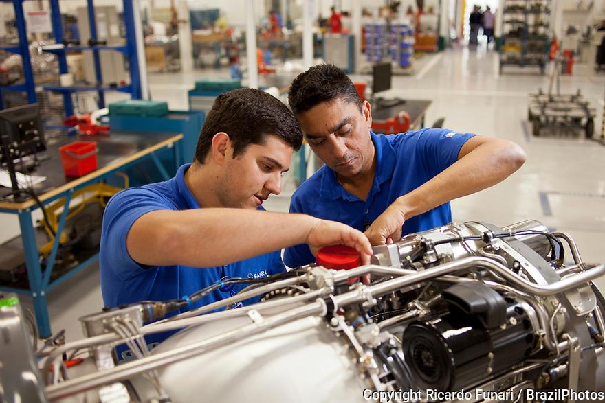 Teamwork, factory workers - mechanics - engine pieces inspection, Brazil.
