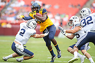 Landover, MD - September 23, 2016: West Virginia Mountaineers wide receiver Devonte Mathis (82) gets tackled by BYU Cougars defensive back Matt Hadley (2) during game between BYU and WVA at  FedEx Field in Landover, MD.  (Photo by Elliott Brown/Media Images International)