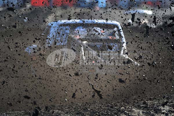 Dec. 18, 2009; Lake Elsinore, CA, USA; An unlimited two driver kicks up dirt and mud in a turn during qualifying for the Lucas Oil Challenge Cup at the Lake Elsinore Motorsports Complex. Mandatory Credit: Mark J. Rebilas-US PRESSWIRE