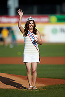 Mrs. West Virginia America 2018 Kassie Lawless waves to the crowd before throwing a ceremonial first pitch prior to the South Atlantic League game between the Lexington Legends and the West Virginia Power at Appalachian Power Park on June 7, 2018 in Charleston, West Virginia. The Power defeated the Legends 5-1. (Brian Westerholt/Four Seam Images)