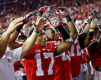Ohio State Buckeyes running back Jalin Marshall (17) sings Carmen Ohio following the 50-28 win over Cincinnati in the NCAA football game at Ohio Stadium in Columbus on Sept. 27, 2014. (Adam Cairns / The Columbus Dispatch)