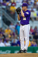 LSU Tigers pitcher Jared Poche #16 looks to his catcher for the sign during the Southeastern Conference baseball game against the Georgia Bulldogs on March 22, 2014 at Alex Box Stadium in Baton Rouge, La. The Tigers defeated the Bulldogs 2-1. (Andrew Woolley/Four Seam Images)