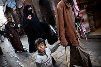 People walk along a street in Sana'a.