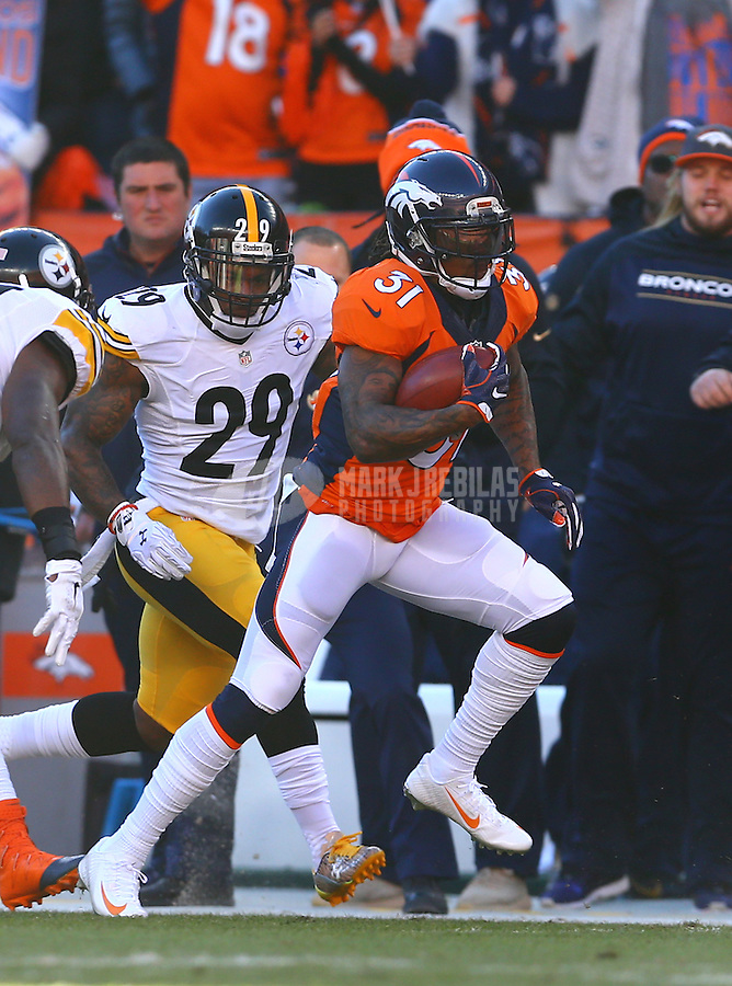 Jan 17, 2016; Denver, CO, USA; Denver Broncos safety Omar Bolden (31) returns a kickoff against Pittsburgh Steelers safety Shamarko Thomas (29) during the AFC Divisional round playoff game at Sports Authority Field at Mile High. Mandatory Credit: Mark J. Rebilas-USA TODAY Sports