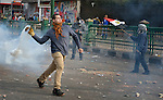 A demonstrator hurtles a smoking tear gas canister back at police during November 25, 2012, protests in and around Cairo's Tahrir Square. The protestors were upset by Egyptian President Mohammed Mursi's November 22nd decision to assume sweeping new powers.