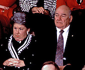 United States President Bill Clinton's Mom, Mrs. Virginia Kelley, listens to her son's first speech to a Joint Session of the U.S. Congress in the U.S. Capitol in Washington, D.C. on February 17, 1993.  At right is her husband, Hugh.
