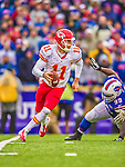 9 November 2014: Kansas City Chiefs quarterback Alex Smith scrambles in the backfield during the first quarter against the Buffalo Bills at Ralph Wilson Stadium in Orchard Park, NY. The Chiefs rallied with two fourth quarter touchdowns to defeat the Bills 17-13. Mandatory Credit: Ed Wolfstein Photo *** RAW (NEF) Image File Available ***