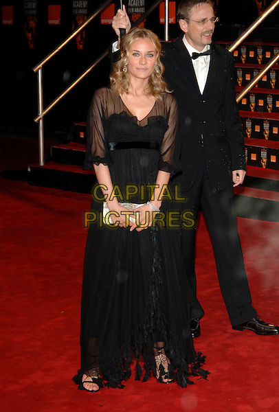 DIANE KRUGER.Arrivals at The Orange British Academy Film Awards .BAFTA's at the Odeon Leicester Square, London, England.February 19th, 2006.Ref: PL.bafta baftas full length black dress sheer silver clutch purse.www.capitalpictures.com.sales@capitalpictures.com.© Capital Pictures.