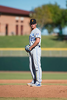 Surprise Saguaros relief pitcher Walker Sheller (49), of the Kansas City Royals organization, looks in for the sign during an Arizona Fall League game against the Scottsdale Scorpions at Scottsdale Stadium on October 26, 2018 in Scottsdale, Arizona. Surprise defeated Scottsdale 3-1. (Zachary Lucy/Four Seam Images)