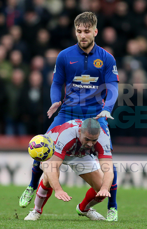Luke Shaw of Manchester United pushes over Jonathan Walters of Stoke City - Barclays Premier League - Stoke City vs Manchester Utd - Stoke - England - 1st January 2015 - Picture Simon Bellis/Sportimage
