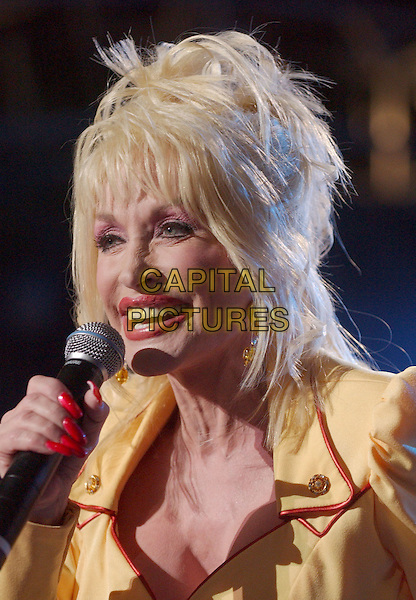 DOLLY PARTON.Performs live on stage at the 2005 CMA Music Festival held at The Coliseum, Nashville, Tennessee, .USA, 09 June 2005..portrait headshot yellow red jacket concert gig .Ref: ADM.www.capitalpictures.com.sales@capitalpictures.com.©AdMedia/Capital Pictures.