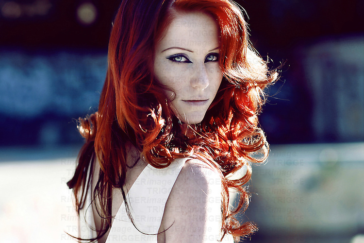 A portrait of a girl with shining red hair.