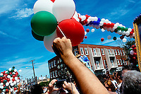 Crowds gather under balloon arches during the Sunday Procession of St. Peter's Fiesta in Gloucester, Massachusetts, USA.