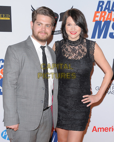 Jack Osbourne & Lisa Stelly .at The 19th Annual Race to Erase MS Gala held at The Hyatt Regency Century Plaza Hotel in Century City, California, USA, May 18th 2012..half length grey gray suit tie black lace mini dress hand on hip fiance couple .CAP/RKE/DVS.©DVS/RockinExposures/Capital Pictures.