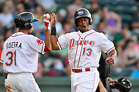 Third baseman Rafael Devers (13) of the Greenville Drive scores from first on a double by Nick Longhi (not pictured) in a game against the Augusta GreenJackets on Thursday, July 16, 2015, at Fluor Field at the West End in Greenville, South Carolina. Devers is the No. 6 prospect of the Boston Red Sox, according to Baseball America. Greenville won, 11-5. (Tom Priddy/Four Seam Images)
