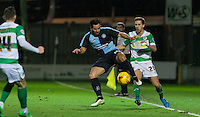 Sam Wood of Wycombe Wanderers controls the ball under pressure from Wes Fogden of Yeovil Town during the Sky Bet League 2 match between Yeovil Town and Wycombe Wanderers at Huish Park, Yeovil, England on 24 November 2015. Photo by Andy Rowland.