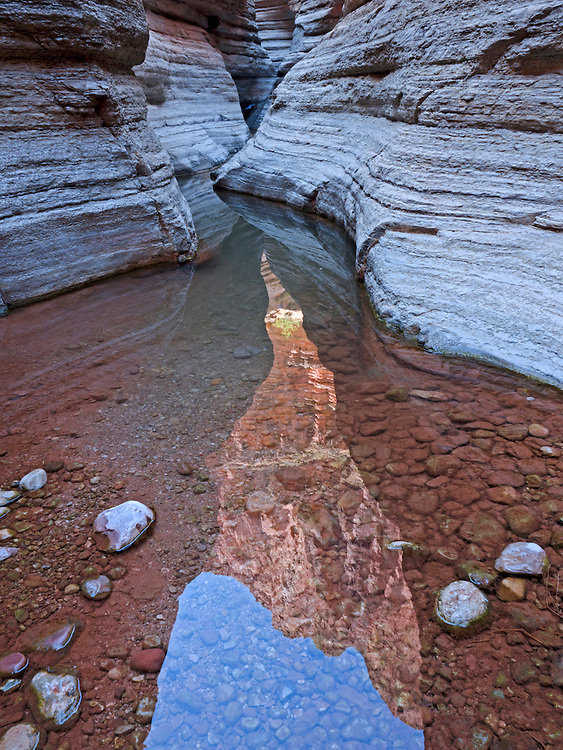 Reflections of the cliffs in the Matkatamiba Canyon, a tributary of the Grand Canyon in the Grand Canyon National Park, Arizona, USA