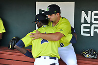 First baseman Chase Chambers (8) of the Columbia Fireflies, right, hugs Ronny Mauricio before a game against the Augusta GreenJackets on Friday, May 31, 2019, at Segra Park in Columbia, South Carolina. Augusta won, 8-6. (Tom Priddy/Four Seam Images)