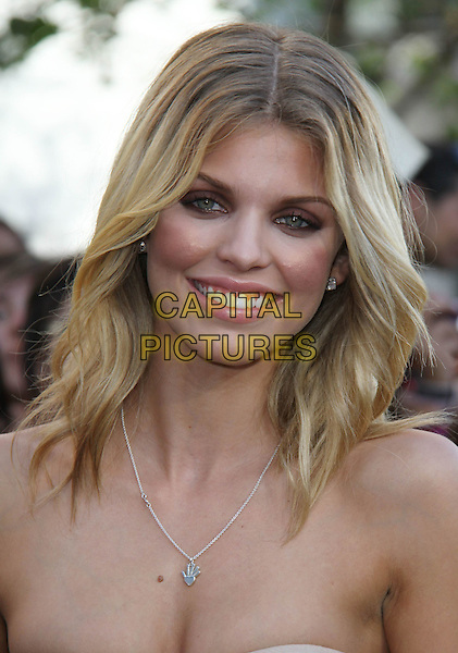 "ANNALYNNE McCORD .""The Twilight Saga: Eclipse"" Los Angeles Film Premiere at the 2010 Los Angeles Film Festival held at Nokia Theatre LA Live,  Los Angeles, California, USA, 24th June 2010..portrait headshot strapless smiling necklace silver hand pendant .CAP/ADM/CH.©Charles Harris/AdMedia/Capital Pictures"