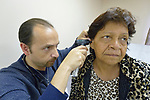 Miguel Madrigal, PA-C, examines Teresa Orozco in a free clinic at the Holding Institute in Laredo, Texas. The institute is supported by United Methodist Women.