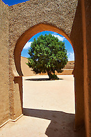 Arabesque adobe arch to the inner courtyard of the  Alaouite Ksar Fida built by Moulay Ismaïl the second ruler of the Moroccan Alaouite dynasty ( reigned 1672–1727 ). Residence of the Khalifa or Caid of Tafilalet until 1965. Tafilalet Oasis, near Rissini, Morocco