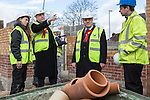 © Joel Goodman - 07973 332324 .  04/02/2014 . Manchester , UK . Ed Balls and Mike Kane talk to apprentice builders . Ed Balls , MP for Morley and Outwood and Shadow Chancellor of the Exchequer the Labour Party , joins Labour candidate Mike Kane on the campaign trail ahead of the Wythenshawe and Sale East by-election , following the death of MP Paul Goggins . They visit apprentices at the Leybrook Road building site in Wythenshawe where apprentice builders work on bungalows built for affordable rent . Photo credit : Joel Goodman