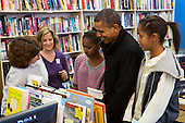 """United States President Barack Obama, center, and daughters Sasha, left, and Malia, right, shop at One More Page Books in Arlington, Virginia on Small Business Saturday, November 24, 2012..Credit: Kristoffer Tripplaar  / Pool via CNP..Pool Report 1: Motorcade left the South Lawn [of the White House] at 1:02 p.m. and arrived in Arlington, Virginia, at One More Page Books at 1:15 p.m. for an OTR (Off the Record) Small Business Saturday event with Sasha and Malia.  From the door of the small book shop, which the White House described as an """"independent, neighborhood bookstore,"""" POTUS (President of the United States) could be seen holding up his BlackBerry, apparently looking up a title, as he spoke with shop owner Eileen McGervey. """"Preparation,"""" the president said. """"That's how I shop.""""  Wearing a dark windbreaker against the blustery weather outside, POTUS handed off a stack of about 10 books to the clerk -- pool was too far away to read titles -- (will send in a later report if we get them) and then shook hands with several employees. He then began to wander through the business with his daughters as pool was escorted out.  """"We're doing Christmas shopping,"""" POTUS said to a question from the pool about the fiscal cliff. """"Happy Thanksgiving, folks.""""  POTUS emerged about 10 minutes later to shake hands for a few minutes with two small groups that formed outside the shop on the sidewalk."""