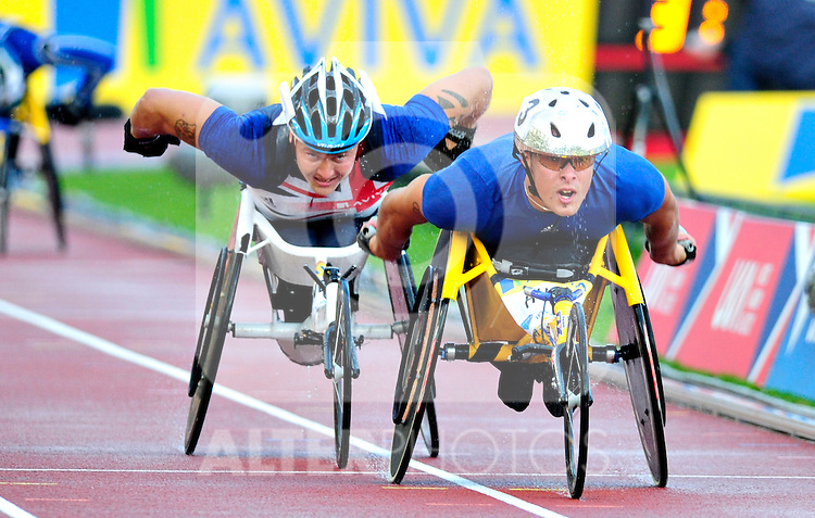 Brain Alldis of Great Britain (L) and Switzerland's Marcel Hug compete in the 1500m T54 during the Samsung Diamond League meeting at Crystal Palace in London August 13, 2010.
