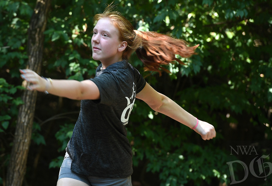 NWA Democrat-Gazette/J.T. WAMPLER Edie Heard of Sherwood watches her drive on hole 2 Sunday August 5, 2018 during the Archibald Yell Classic disc golf tournament at Waxhaws Disc Golf Course at Walker Park in Fayetteville. More than fifty disc golfers played in the annual tournament. The course is on the site of and named after Archibald Yell's old estate in south Fayetteville. Yell was ArkansasÕs first congressman and second governor.