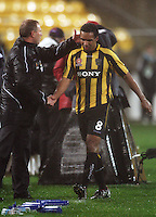 Phoenix coach Ricki Herbert congratulates goalscorer Paul Ifill after subbing him off during the A-League football match between Wellington Phoenix and Perth Glory at Westpac Stadium, Wellington, New Zealand on Sunday, 16 August 2009. Photo: Dave Lintott / lintottphoto.co.nz
